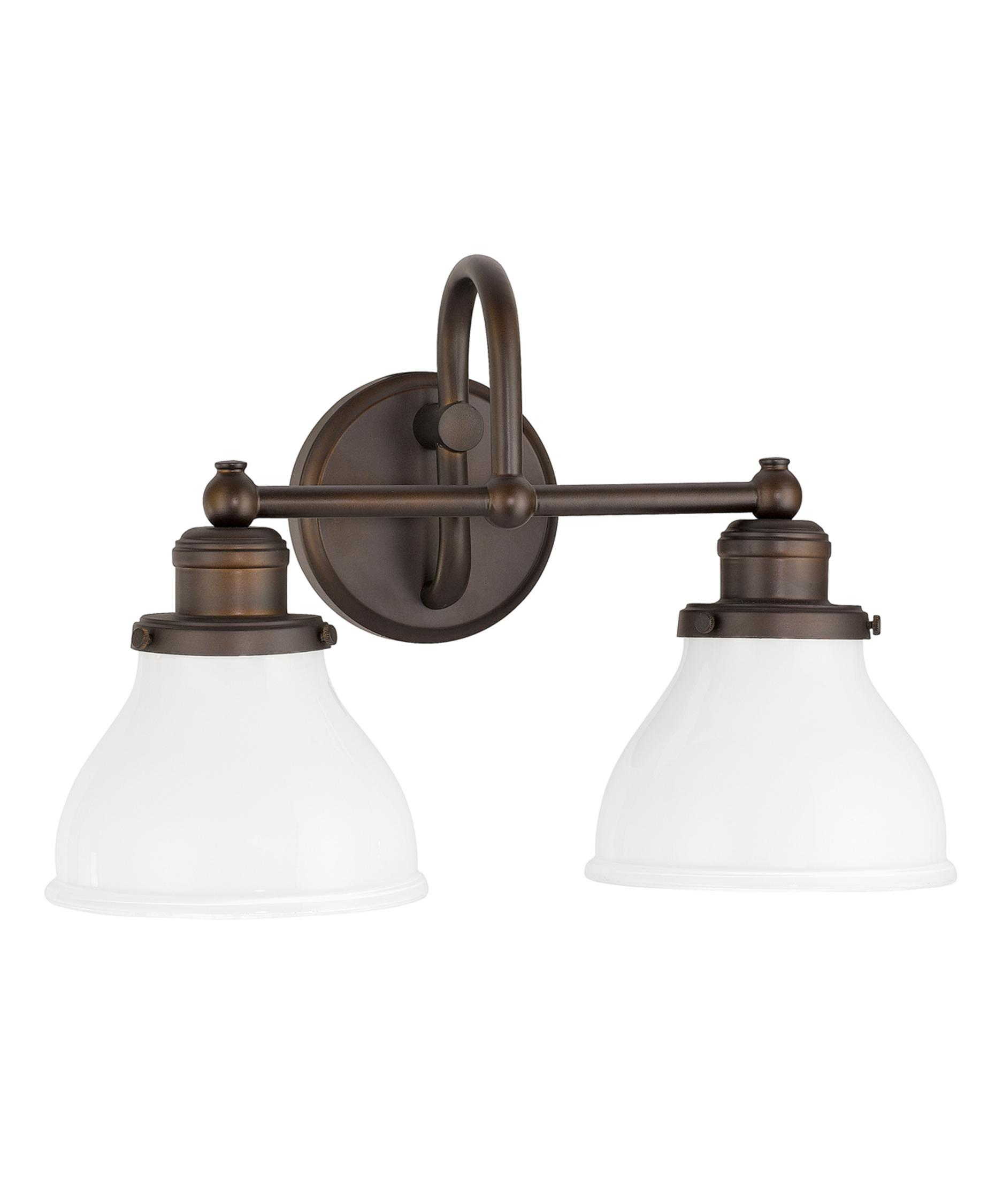 shown in burnished bronze finish and milk glass bathroom vanity lighting 1